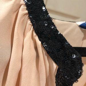 Blush blouse with black sequin trim
